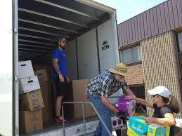 Cedar Rapids Trucking Company Filling Two Trailers With Supplies ...
