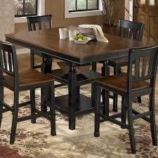 Ortanique Dining Room Table by Signature Design By Ashley Rolena 5piece Round Dining Room Table