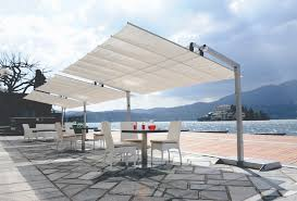 Rectractable Awnings That Keep You In The Shade While Still ... Retractable Awning Umbrella How To Build An Outdoor Canopy Hgtv Storefront Awnings And Canopies Brooklyn Signs Over Patio To A Screened In Family Hdyman Buy Marquees Umbrellas Brisbane Gold Coast Fold Out Blind Systems Roofs Free Standing Perth Commercial Republic 15 Motorized Xl With Woven Acrylic Fabric Christopher Knight Home Catalina Yuma Folding Alinum Fniture Umbrellac2a0 Parts Suppliers