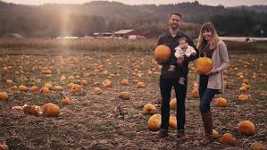 Wheatfield Pumpkin Patch by Portrait Of A Young Family At A Pumpkin Patch Mom And Dad Holding