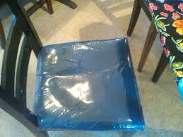 A Ripped Vinyl Cover Dining Chairs Room With Arms