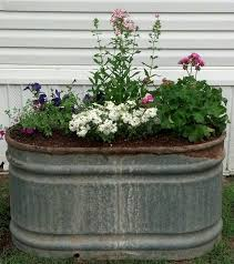 Today I Repurposed An Old Rusted Galvanized Water Trough Into A Rustic Looking Raised Flower Bed