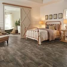 Inspiration For A Large Farmhouse Master Vinyl Floor And Brown Bedroom Remodel In Vancouver With