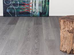 Well Liked Twilight Cork Oak Grey Wood Floors With Sweet White Wall Painted And Artwork Decals In Modern Living Room Designs