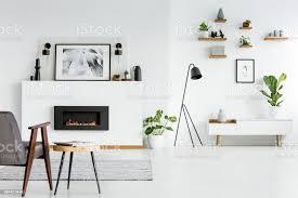 graue sessel neben tisch scandi wohnzimmer interieur mit schwarzen kamin und poster echtes foto stockfoto und mehr bilder biologie