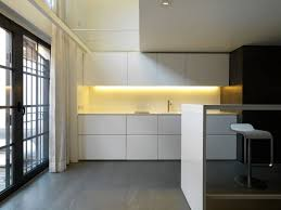 appliances large kitchen window with cabinet lighting