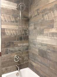 rustic shower with the wood looking porcelain tiles on the