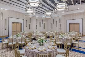 Ballroom Wedding Reception Decor With Rustic Wooden Chairs At Clearwater Beach Venue Wyndham Grand