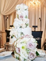 White Wedding Cake With Fresh Pink And Ivory Flowers