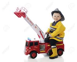 100 Fire Truck For Toddlers An Adorable Toddler Happily Playing Man On His Toy