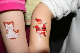 Though You May Not Equate Tattoos With The Holiday Season Temporary Can Be Perfect For Christmas Parties Kids And New Years Eve