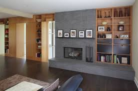 impressive mantel shelves in family room modern with art above