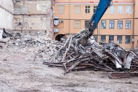 Demolition Truck In Action. Heap Of Rubble And A Demolished Building ...
