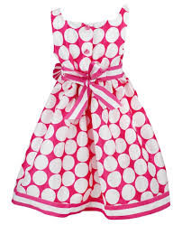 and white polka dot dress with matching cardigan