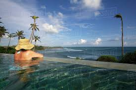 100 Resorts With Infinity Pools Women In Palm Fringed Infinity Pool With Sea View At Cape Weligama