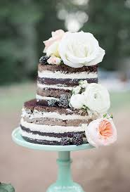A Naked Chocolate Wedding Cake Draped In Lush Fresh Flowers