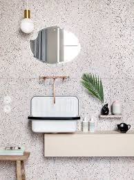 White Terrazzo With Black Dots And Copper Fixtures For A Chic Look