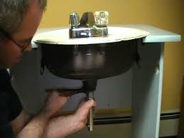 Removing Old Sink Stopper by Old Plumber Shows How To Install A Drain On A Bathroom Sink Basin