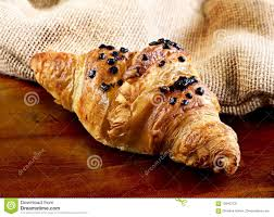 Delicious Chocolate Croissant With Topping Gourmet Eating Scene Wooden Table And Fresh Butter
