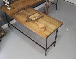 l shaped reclaimed wood corner desk top surface and cast iron pipe