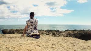 Thoughtful Girl Sitting Alone At Beach Young Woman Looking The Ocean On A High