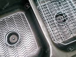 Kitchen Sink Protector Mats by Double Bowl Kitchen Sink With White Mats And Dish Drainer Stock