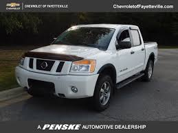 2012 Used Nissan Titan 4WD Crew Cab SWB PRO-4X At Fayetteville ... Fairbanks Used Nissan Titan Vehicles For Sale 2014 4x4 Colwood Cart Mart Cars Trucks 2017 Truck Crew Cab For In Leesport Pa Lebanon Used Nissan Titan Sl 4wd Crew Cab Truck For Sale 800 655 3764 2010 Xe At Woodbridge Public Auto Auction Va Iid 2006 Se Stock 14811 Sale Near Duluth Ga New 2018 San Antonio Car Dealers Chicago 2016 Xd Vernon Platinum Reserve 4x4 Wnavigation