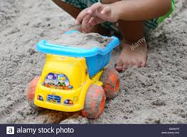 Kid Playing A Plastic Dump Truck Car Stock Photo, Royalty Free ... Classic Metal 187 Ho 1960 Ford F500 Dump Truck Yellow The Award Wning Hammacher Schlemmer Toy Wheel Loader Stock Photo 532090117 Shutterstock Amazoncom Small World Toys Sand Water Peekaboo American Plastic Mega Games Amloid Kids At Work With Blocks Playset Day To Moments Gigantic Tonka 2001 With Sounds 22 12 Length Hasbro Colorful On 571853446 Dump Truck Model On A Road Transporting Gravel Toy Ttipper Industrial Image Bigstock