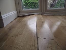 Hardwood Floor Cupping And Crowning by Warped Floorboards Caused By Humidity Swings Woodfloordoctor Com