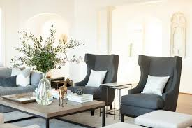 gray linen wingback chairs and nesting end tables transitional