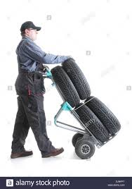 Serviceman Carrying A Set Of Four New Car Tires Using Hand Truck ... Milwaukee 800 Lb Capacity 2in1 Convertible Hand Truckcht800p Milwaukee Hand Trucks 32152 Truck With 8inch Puncture Harper Hand Truck Tires Tools Compare Prices At Nextag Marathon Tires Flatfree Tire 34in Bore 410350 Golf Cart And Industrial Vehicle Archives Amerityre Cporation Handtrucks Ace Hdware For Replacement Universal Fit Industries Martin Wheel 4103504 10 In Sawtooth 214 New Flat Free 58 Dolly Wheels Tubeless Steel Dutro Gemini Senior Balloon Cushion 750 4wheel Allterrain Airless