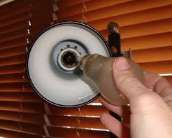 remove broken light bulbs without getting cut or shocked using a