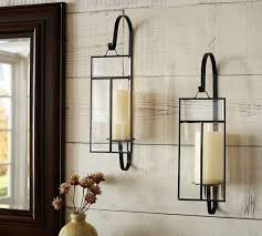 iron and paned glass candle wall sconce