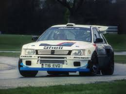 Peugeot 205 T16 Racer Is Actually A Mitsubishi EVO VI In Drag