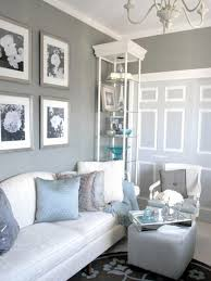 grey wall theme and grey blue cushions on white fabric sofa