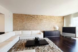 steinwand im wohnzimmer mit diesen kosten müssen sie rechnen