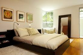contemporary master bedroom with hardwood floors carpet in
