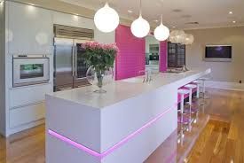 Modern Kitchen Design With White Cabinets Lighting Fixtures Pink Accent Wall And Decorative