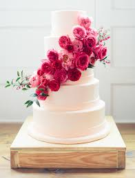 This cake adorned with hot pink peonies