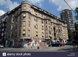 Old Run Down Apartment Block On Street In Belgrade