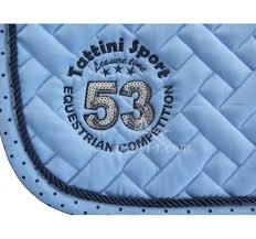 tapis de selle bleu tattini avec ruban a pois strass et logo broder