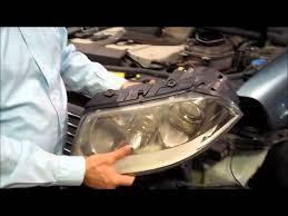 vw passat headlight bulb replacement