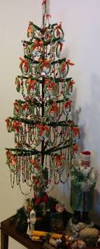 Antique Decorated Tree With A Collection Of Bottle Brush Wreaths Santa Face