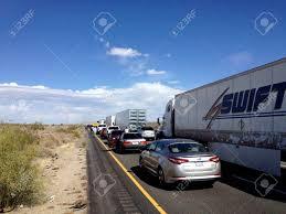 100 2014 Cars And Trucks Chiriaco CA APRIL 11 People Walking Along Idle Stock