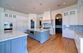 Luxury Kitchen With Blue And White Main Cabinets Painted Island Marble Counters