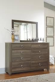 Zayley Dresser And Mirror by Birmington Brown Dresser From Ashley Coleman Furniture
