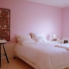 a bit of blush on the walls cool white bedding and a spartan