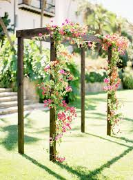 Simple Rustic Arbor With Fuchsia Floral Wedding Flowers Arch