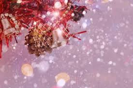Colorful Image With Small Red Christmas Tree And Falling Snow Stock Photo