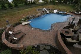Brick Patio With Pool Slide Diving Board